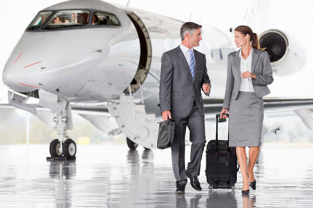 Business travelers fly private jet charter