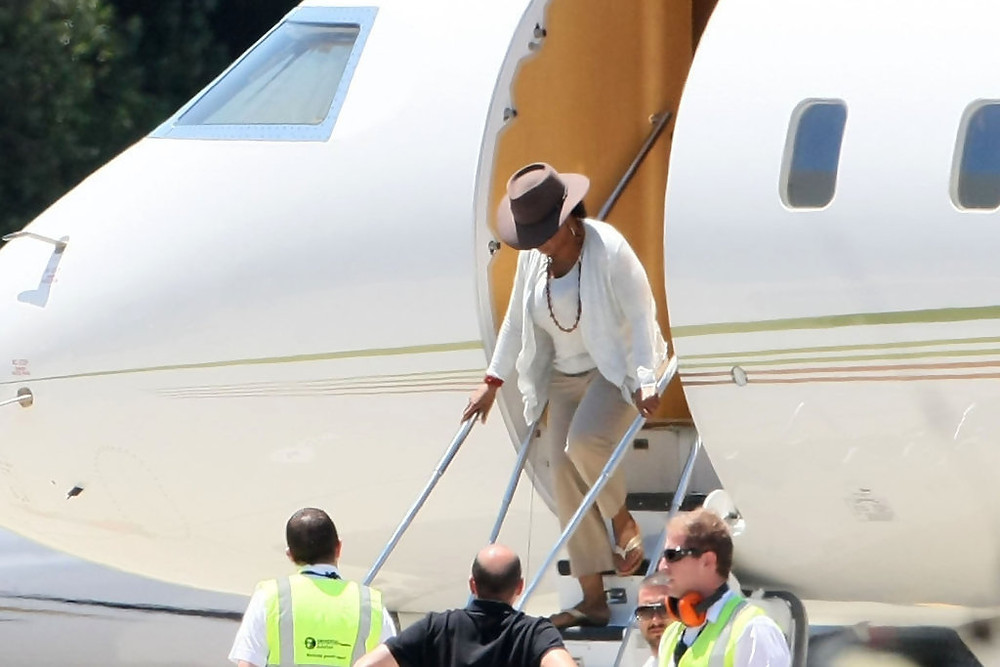 Oprah Winfrey stepping out of her private jet.