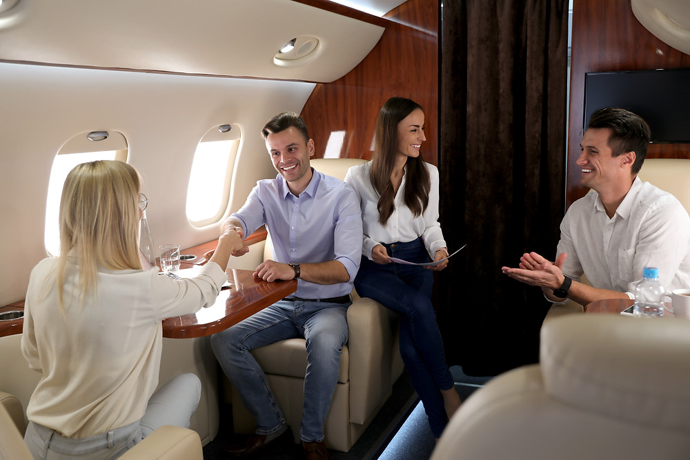 People enjoy their time on a private jet.