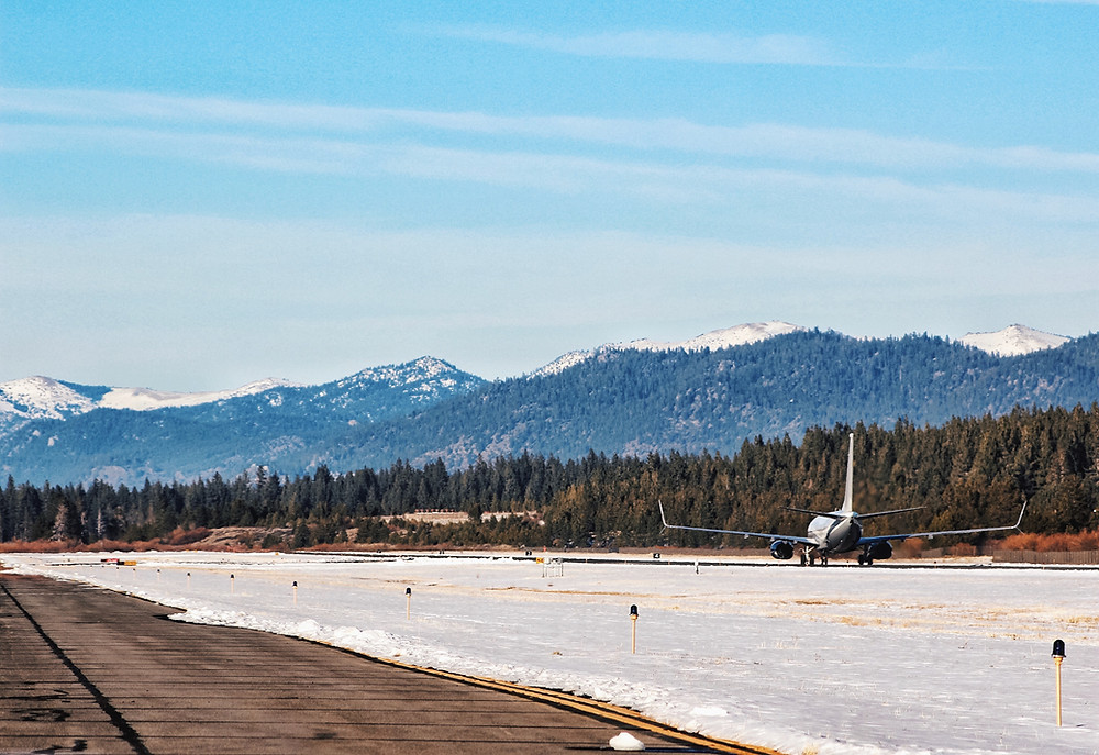 Private jet takes off on snow and ice.