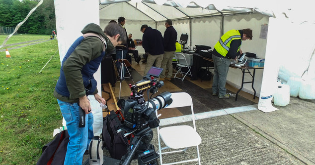 Setting up tent on location