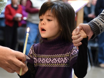 Young girl holding a candle