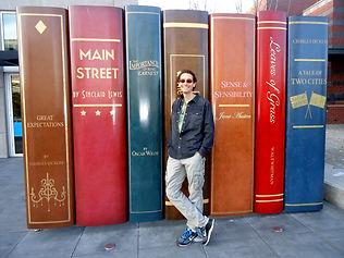 Matt Lome standing with books