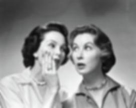 1950s-1960s-two-women-gossiping-one-vint