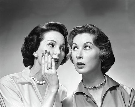 1950s-1960s-two-women-gossiping-one-vint