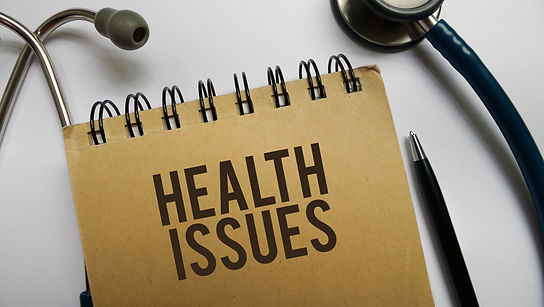 Health issues memo written on a white ba