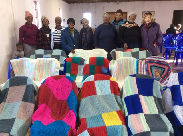 After completing the baby blanket project,the ladies of the coffee morning group are now busy knitting kneeblankets for the elderly and persons in wheelchairs. Seventeen blanket are already completed. Once the rest is completed it will be handed over to Sr Hettie from the department of community welfare for distribution.Some blankets will also be handed over to  house AA Tomlinson. The  Coffee Morning is a project of the Rotary Club of Swellendam who provide the wool and refreshments