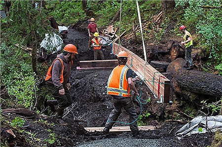 Crews work on bridge on Treadwell Ditch trail in Juneau