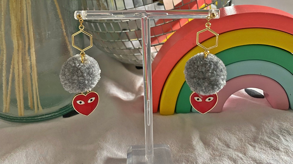 Small grey pom pom earrings on hexagon connectors with heart charms