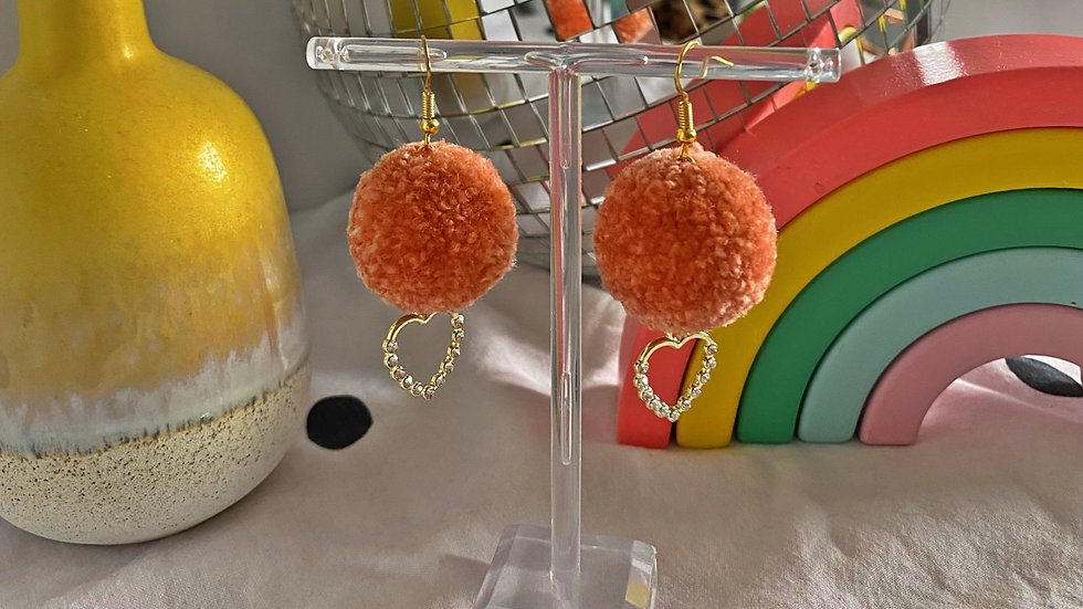 Peach pom pom earrings with gold and crystal heart charms