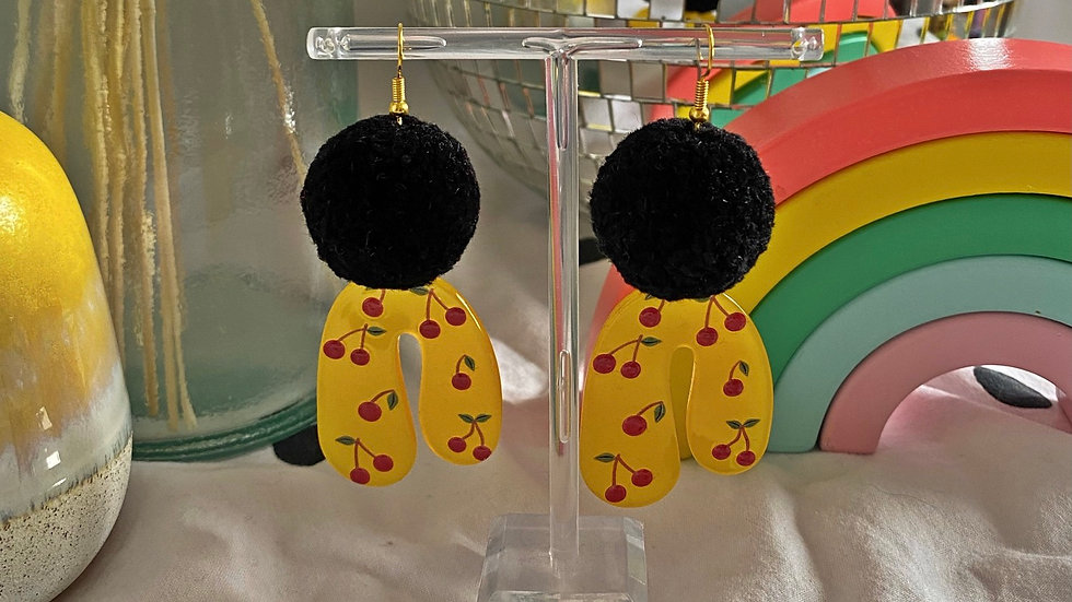 Black pom pom earrings with cherry arch charms
