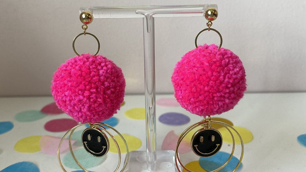 Neon pink poms with double circle connectors and black smiley face charms
