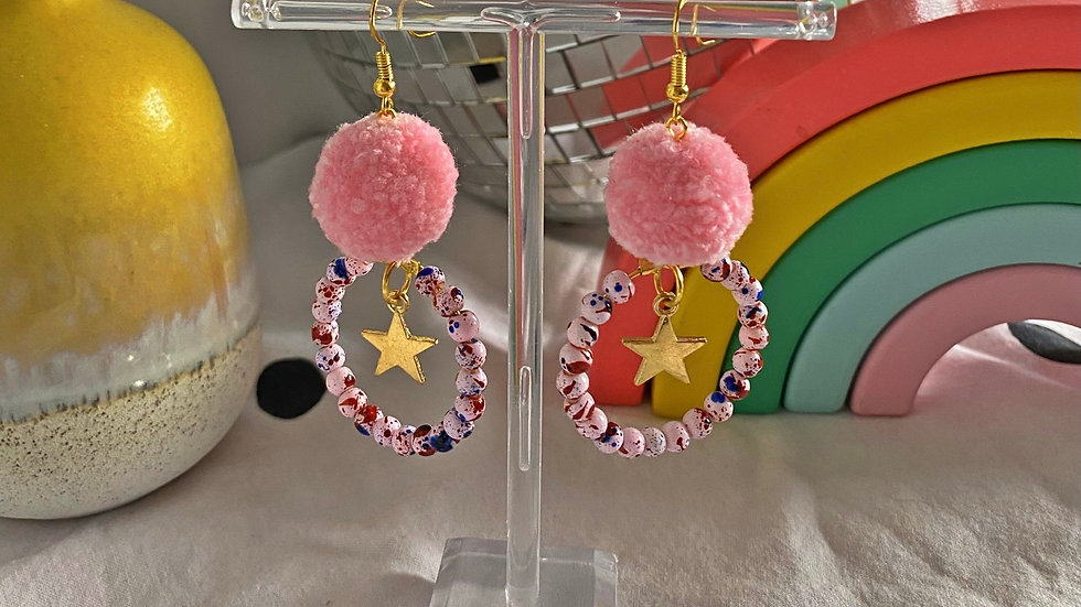 Mini pink pom poms with marbled beads and star charms