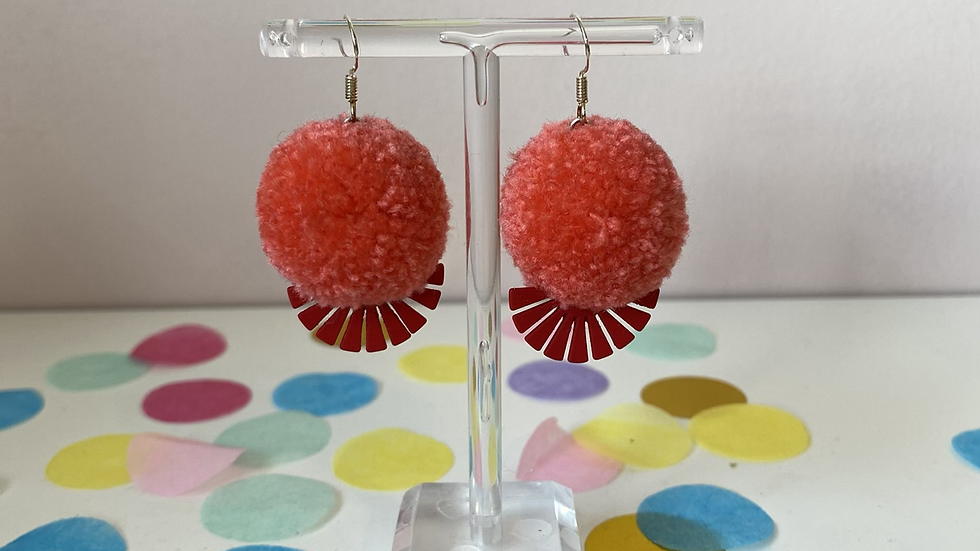 Coral poms with red fan charms