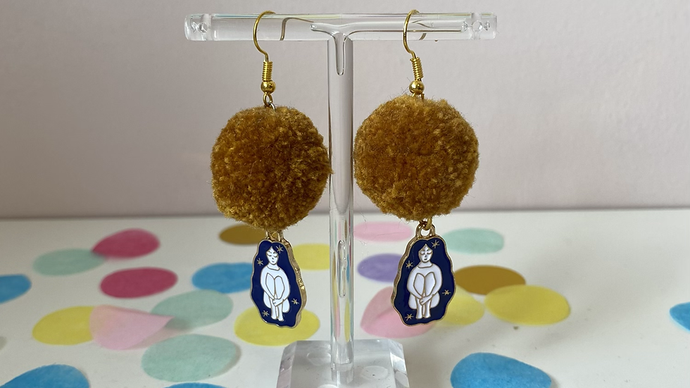 Mustard pom poms with female goddess charms