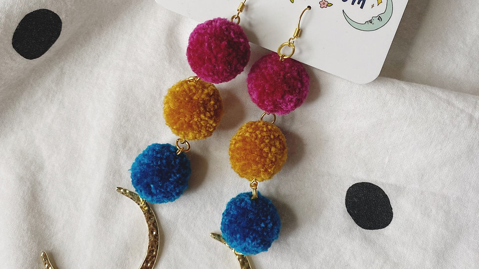 Triple pom dangles in jewel tones with XL gold crescent moon charms