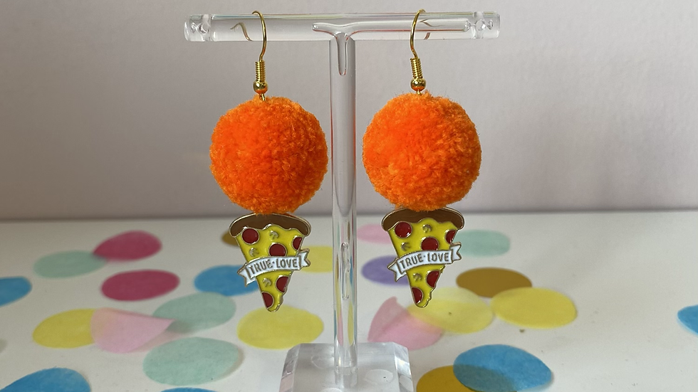 Bright orange poms with 'true love' pizza charms