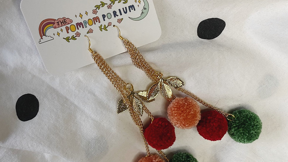 Green, burgundy and blush dangle poms with golden leaf charms