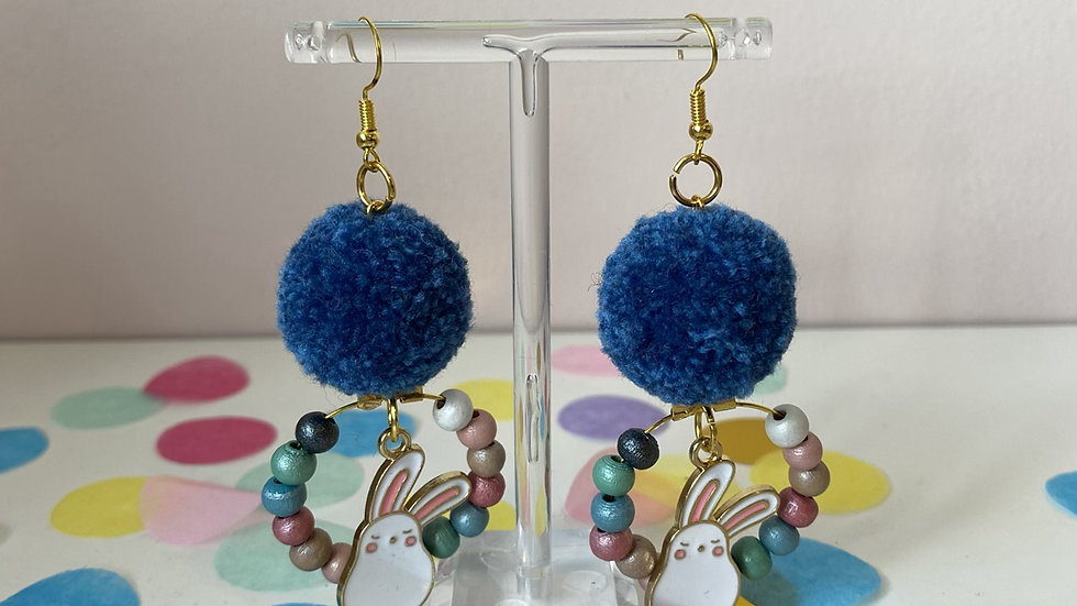 Denim blue poms with bunny charms and a beaded wreath