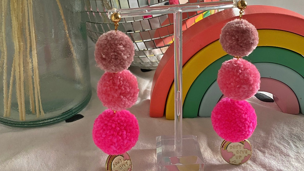 Pink ombré pom pom earrings with 'don't give up' charms