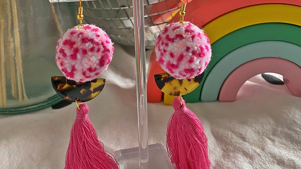Pink speckle pom pom earrings with tortoiseshell half moons and pink tassels