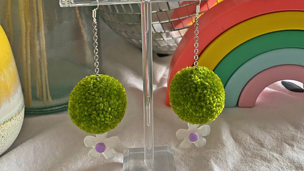 Lime green pom poms with acrylic daisy charms