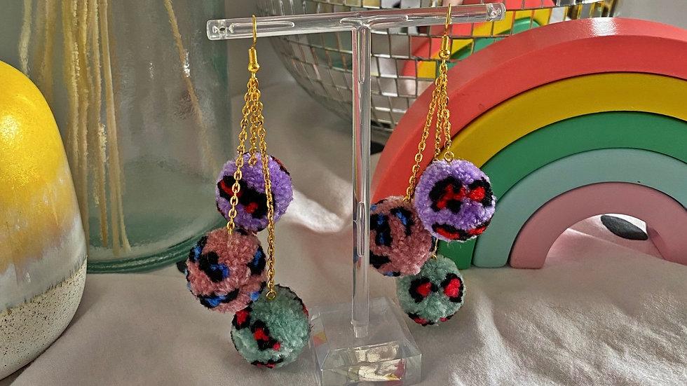 Pastel leopard print multi pom dangle earrings