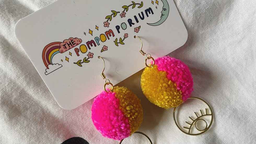 Neon pink & mustard pom poms with circular eye charms