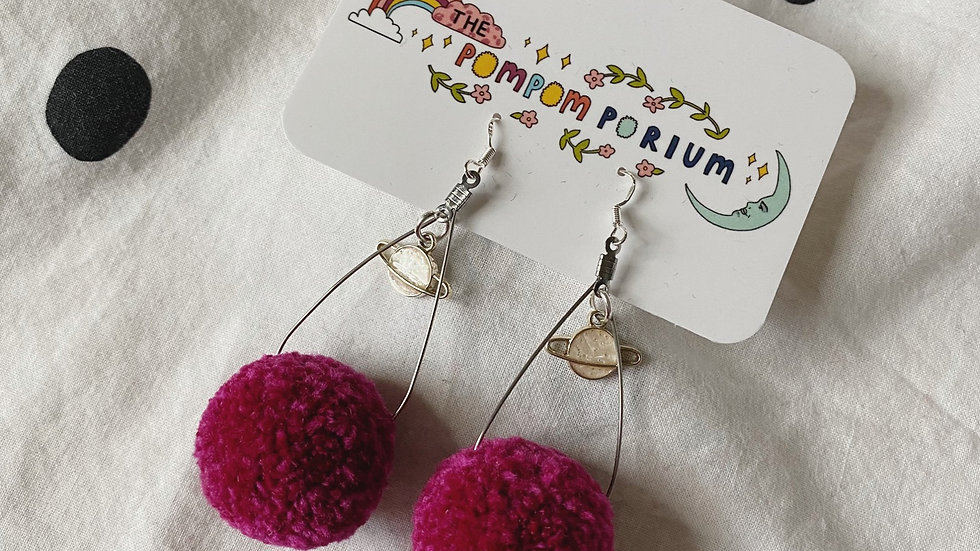 Silver teardrops with planet charms and raspberry poms