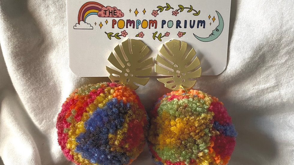 Gold monstera studs with XL tie dye style poms