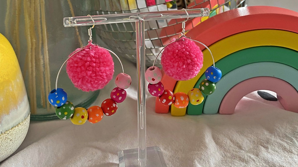 Pink poms pom earrings with floral rainbow beads