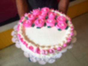 Cake with pink rose