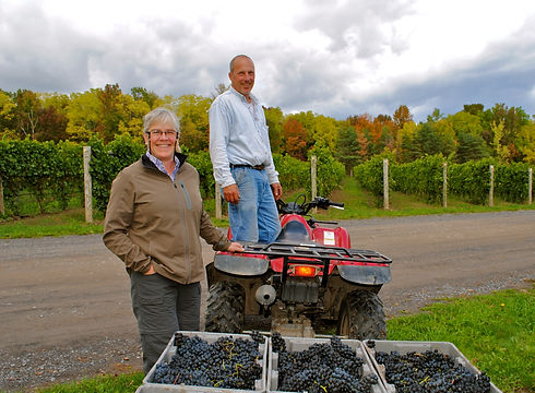 Nancy and Mike in front of their harvest
