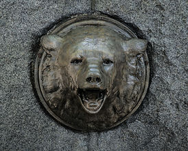 a closeup of a sculpture of a bear head
