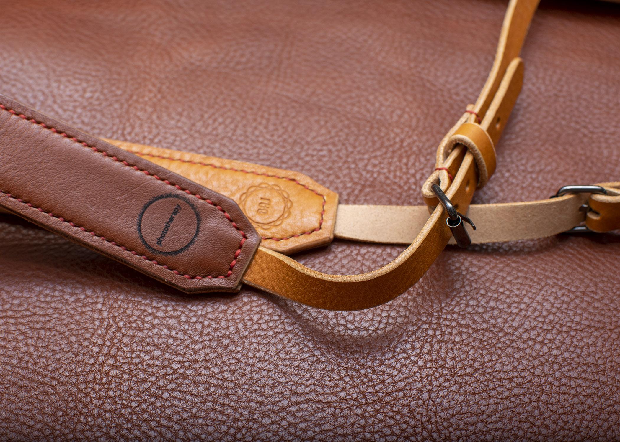camera strap on brown
