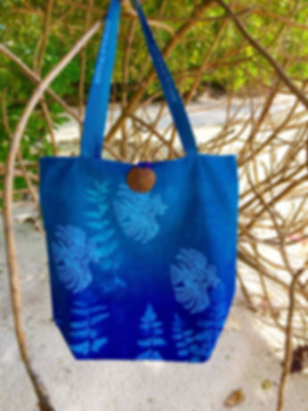 Lion fish swimming under water on our screen printed tote bag