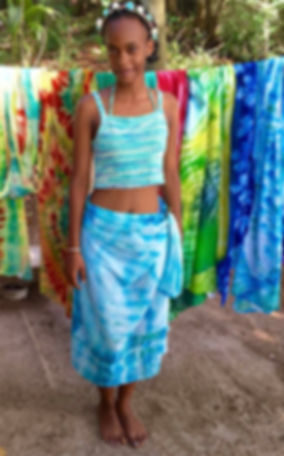 Kreol girl wearing African tie and dye pareo sarong