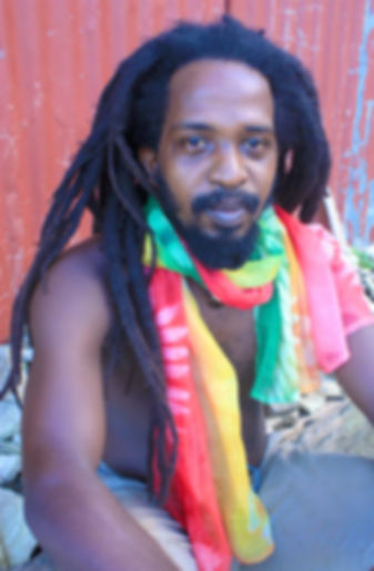 Red gold and green cotton scarf on Rasta