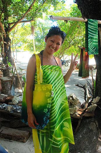 Tote bag and sarong on happy tourist