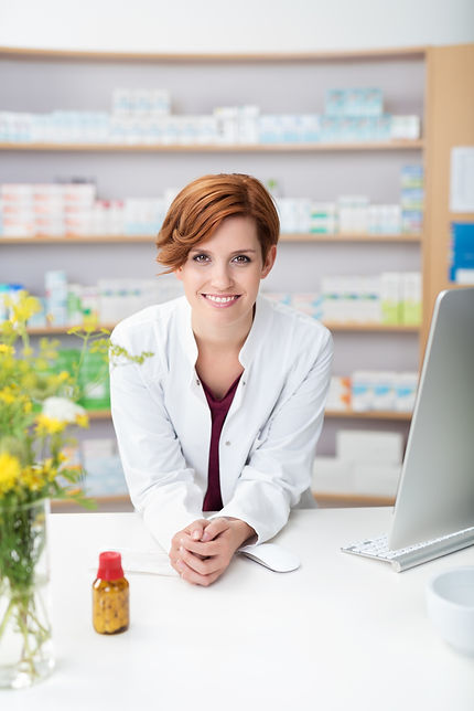 Friendly smiling young woman pharmacist