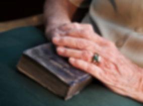 orig_old_hands_on_bible.jpg