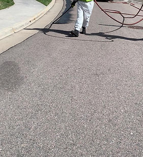 Sealcoating road with hose