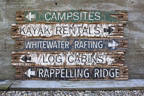 Rustic wood Lodge signs
