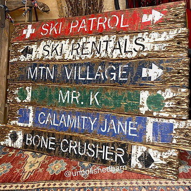 rustic wood ski trail signs