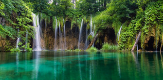 Waterfall in forest. Crystal clear water
