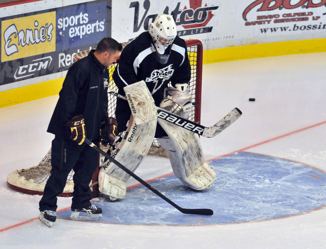 Instructing goaltender on details of crease efficiency and net coverage