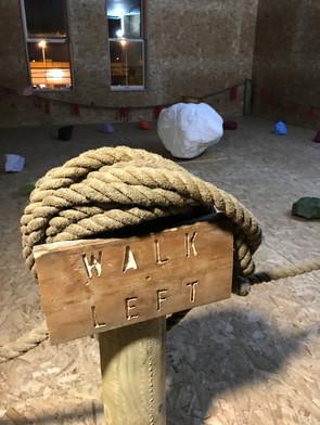 """""""Walk Left"""" signage"""