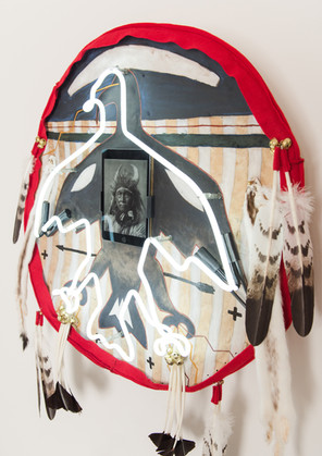 "This piece is featured on the Neubauer Collegium's publication on major exhibiton ""Apsáalooke Women & Warriors""   Traditionally sourced bison hide, Neon light, Ipad, earth pigments, wool, brass, ermine skin, imitation eagle & hawk feathers, plexiglass, steel, rubbber, nylon, various electrical components. 39.75""(h) x 30.25""(w) x 6""(d)  Available for purchase. Any inquiries can be sent directly to the artist, art@benpeasevisions.com"