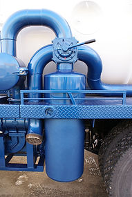 Blue and White Vacuum Truck Close Up fro