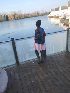 Lady standing by the lake